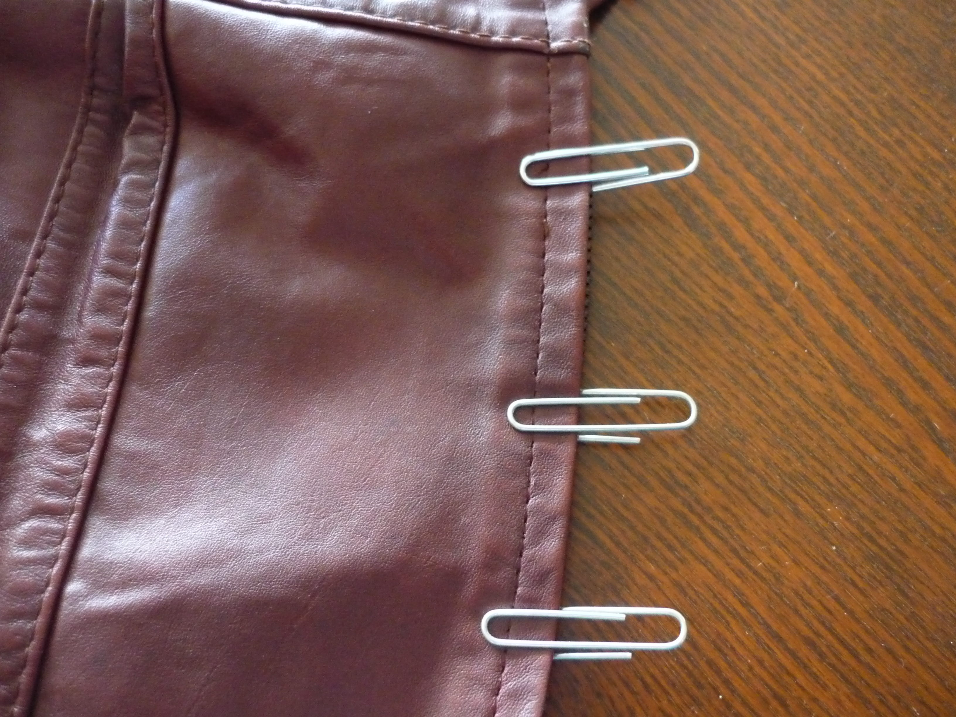 Leather jacket repair vancouver - Continue Pinning With Paper Clips Along The Length Of The Zipper At The Top Tuck The Tail End Inside So It S Not Visible