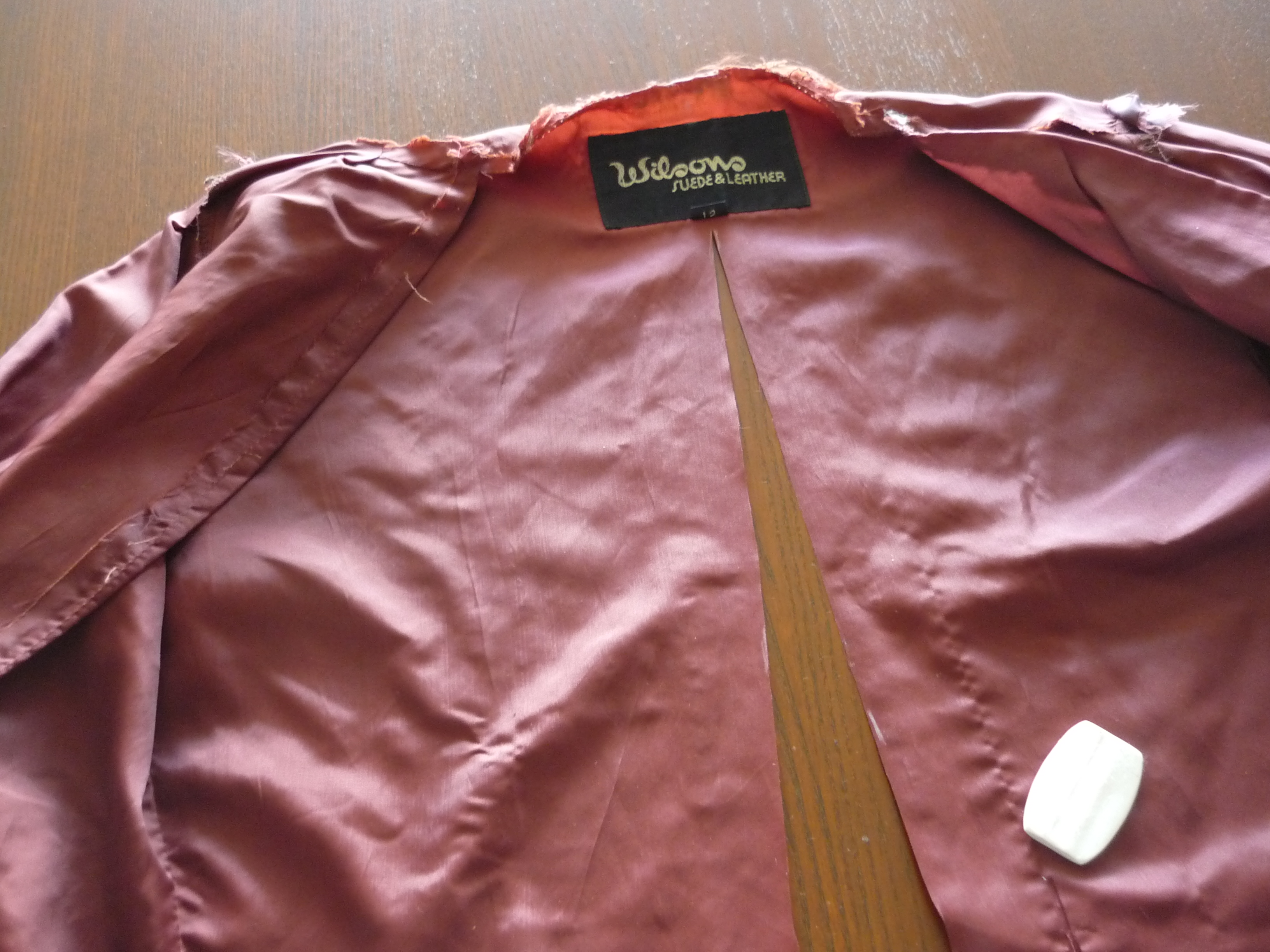 Leather jacket repair vancouver - Slice The Back Lining Piece Up The Middle Now You Have A Half Jacket Choose The Half With Less Rips And Holes To Use For The Next Step