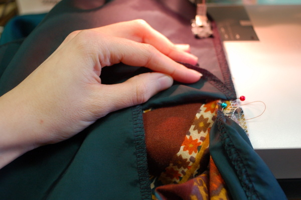 sew lining to dress along centre back opening