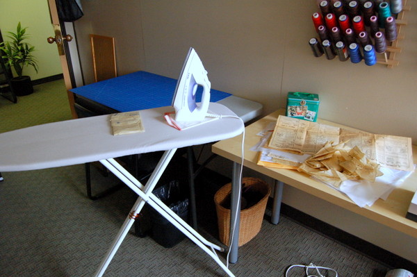 ironing board and sewing room setup