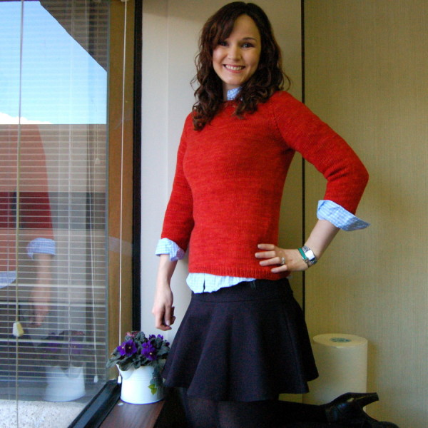 orange sweater, buttondown, black skirt and boots
