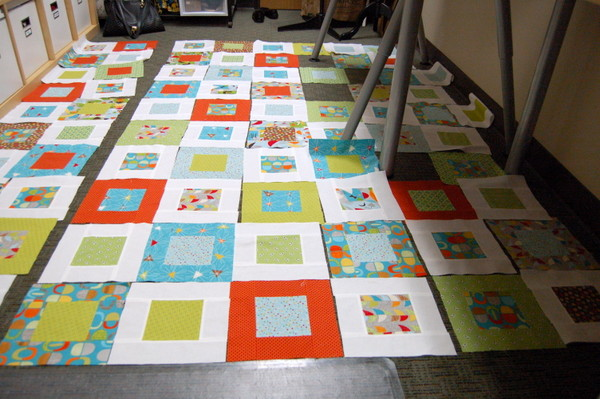 laying out quilt blocks on the floor