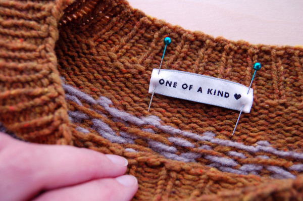 sewing labels into handknit sweaters 2