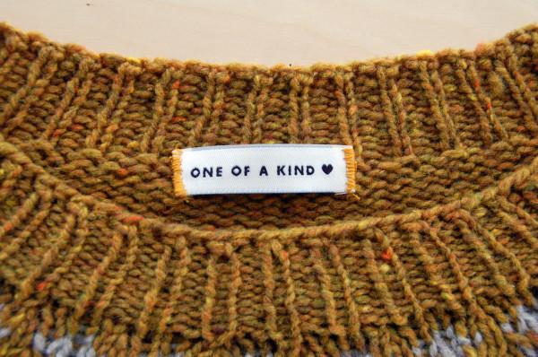 sewing labels into handknit sweaters 4
