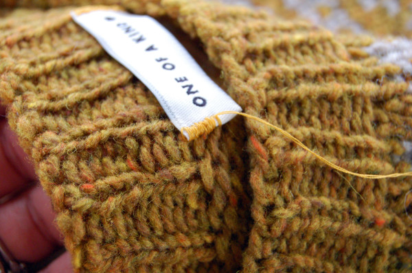 sewing labels into handknit sweaters 5