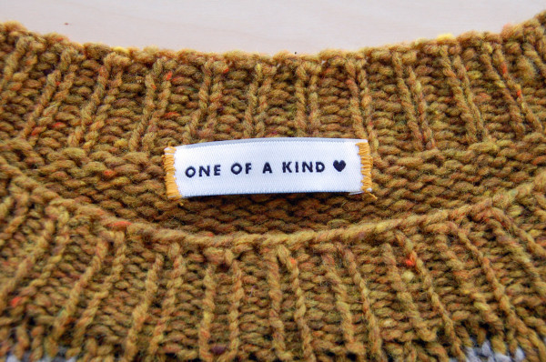 sewing labels into handknit sweaters 6