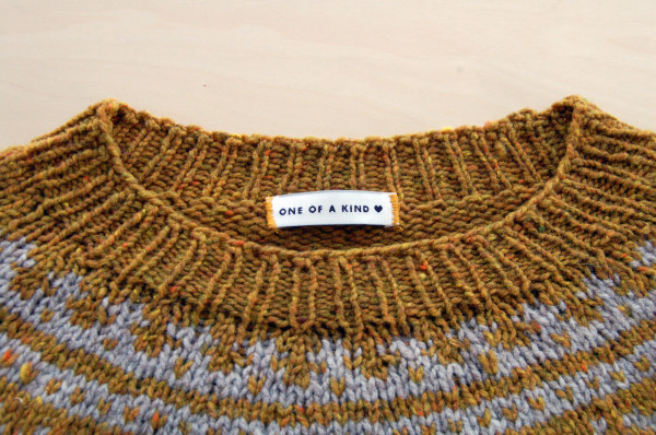 sewing labels into handknit sweaters 7